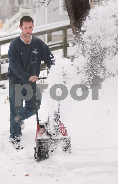 Kyle Bursaw – kbursaw@daily-chronicle.com<br /> <br /> Justin Heuer snowblows his driveway in DeKalb, Ill. on Tueday, Dec. 21, 2010.