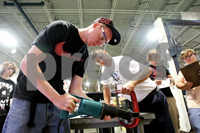 Rob Winner – rwinner@daily-chronicle.com<br /> <br /> Kyle George (left), of Sandwich, learns how to use a reciprocating saw as instructor Nick Little watches over him at the Indian Valley Vocational Center in Sandwich, Ill. on Thursday September 16, 2010.