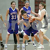 Rob Winner – rwinner@daily-chronicle.com<br /> Hinckley-Big Rock's Kaitlin Phillips (left) and Elgin Academy's Brigitte Keslinke battle for a ball during the first half of Thursday night's sectional game. Hinckley-Big Rock defeated Elgin Academy, 62-35.