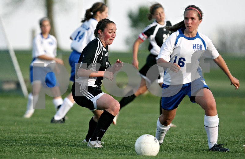 Rob Winner – rwinner@daily-chronicle.com<br /> <br /> Kaneland's Abby Bend (left) goes back for control of a ball kicked away by Hinckley-Big Rock's Hannah VanderMoere during the first half of their game in Hinckley, Ill. on Wednesday April 28, 2010.