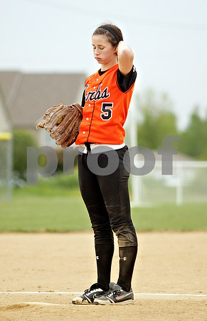 Beck Diefenbach  -  bdiefenbach@daily-chronicle.com<br /> <br /> DeKalb pitcher Tia Lexa (5) takes a deep breath between pitches during the fourth inning of the game against Sycamore at Sycamore High School in Sycamore, Ill., on Monday May 10, 2010.