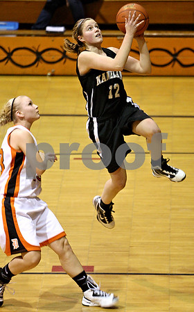 Rob Winner – rwinner@daily-chronicle.com<br /> Kaneland's Emily Heimerdinger puts up two late in the second half after a steal during their game in DeKalb on Friday January 22, 2010.