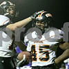Rob Winner – rwinner@daily-chronicle.com<br /> <br /> DeKalb's Dan Matya (left) celebrates with teammate Leshun Daniels after a two point conversion after a touchdown during the second quarter in Rochelle, Ill. on Friday October 22, 2010.