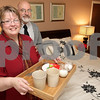 Kyle Bursaw – kbursaw@daily-chronicle.com<br /> <br /> Pamela and Bob Snow, the owners of Parkside Bed and Breakfast at 203 E. Roosevelt St, bring breakfast to guests from their attached home. Besides the pictured bedroom Parkside Bed and Breakfast also offers living room and kitchen areas. <br /> <br /> 12/17/2010