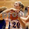 Beck Diefenbach  -  bdiefenbach@daily-chronicle.com<br /> <br /> Hinckley-Big Rock's Jenna Thorp (20) tries to shoot the ball despite multiple Newark defenders during the fourth quarter of the game against Newark at H-BR High School in Hinckley, Ill., on Thursday Jan. 14, 2010. H-BR defeated Newark 46 to 30.