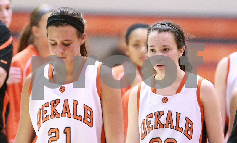 Kyle Bursaw – kbursaw@daily-chronicle.com<br /> <br /> Kelli Gerace and Taylor White look dejected after the Barbs lost.<br /> The DeKalb girls fell to the Wheaton Warrenville South Tigers 33-37 at Naperville North High School in Naperville, Ill. on Thursday, Dec. 23, 2010.