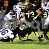Wendy Kemp - For The Daily Chronicle<br /> Sycamore's Eric Ray (5) pushes through Rochelle's defense during Friday's game.<br /> Sycamore 10/8/10