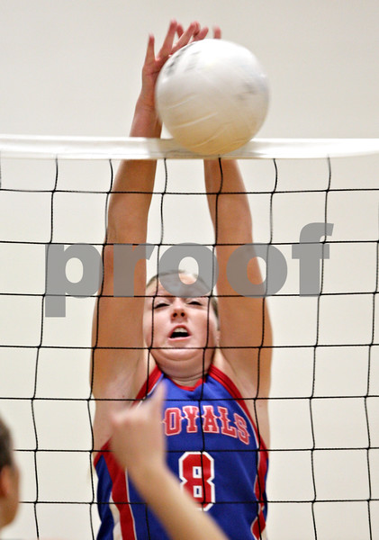 Beck Diefenbach – bdiefenbach@daily-chronicle.com<br /> <br /> Hinckley-Big Rock's Emily Stege (8) blocks a shot during the first game of a match against Hiawatha at Hiawatha High School in Kirkland, Ill., on Thursday  Sept. 16, 2010. H-BR defeated Hiawatha 2 to 0.