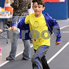Wendy Kemp/For The Chronicle<br /> Riley Wells, 9, of Genoa runs during the mini-relay marathon at the Kishwaukee YMCA on Saturday.<br /> Sycamore 4/18/10