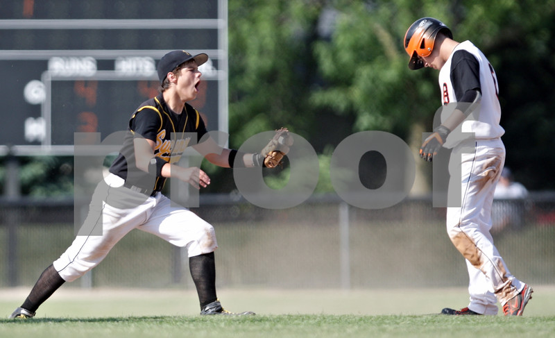 Rob Winner – rwinner@daily-chronicle.com<br /> <br /> Sycamore's Zack Spiewak reacts after DeKalb's Kevin Sullivan is called safe on a steal in the fifth inning during the IHSA Class 3A DeKalb Sectional semifinal on Wednesday June 2, 2010 in DeKalb, Ill.