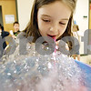 "Rob Winner – rwinner@daily-chronicle.com<br /> <br /> Hannah Foust, 7, catches her breath while blowing into a bowl of colored bubbles for a painting at Gwendolyn Brooks Elementary School in DeKalb, Ill. on Tuesday March 30, 2010. This week local schools are celebrating Fine Arts Week and Brooks School's theme is ""Under the Sea."""