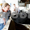Rob Winner – rwinner@daily-chronicle.com<br /> <br /> Cindi Cinnamon, of Shabbona, interacts with one of the dairy cows at the Buchholz Dairy Farm in Malta, Ill. on Tuesday June 15, 2010. Cinnamon is taking part in the 2010 Summer Agriculture Institute, which is a course designed to help teachers make learning relevant by infusing farm and food concepts into the curriculum.