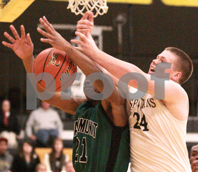 Kyle Bursaw – kbursaw@daily-chronicle.com<br /> <br /> Spartan Nate Swanberg and Catamount Bennie Daniel fight for a rebound in the second quarter. The Sycamore Spartans defeated the Gary Comer College Prep Catamounts  51-48 during the Leland G. Strombom Tournament on Friday, Nov. 26, 2010