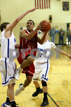 Rob Winner – rwinner@daily-chronicle.com<br /> Indian Creek's Eddie Soler goes to the basket in the first half during a game against Newark in Somonauk, Ill. on Thursday February 4, 2010.