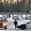 Rob Winner – rwinner@daily-chronicle.com<br /> <br /> County and local DeKalb Police officers direct traffic near the intersection of Clifford Drive and Ellwood Avenue during a standoff on Monday evening in DeKalb.