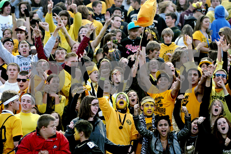 Rob Winner - rwinner@daily-chronicle.com<br /> <br /> Spartans fans cheer on their team before the start of Friday night's game against Burlington Central in Sycamore, Ill.