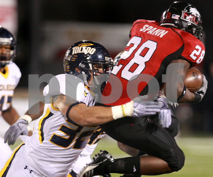 Kyle Bursaw - kbursaw@daily-chronicle.com<br /> <br /> Toledo linebacker Dan Molls (32) tackles  Northern Illinois running back Chad Spann (28) in the first quarter in DeKalb, Ill. on Nov. 9, 2010