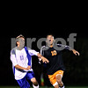 Beck Diefenbach – bdiefenbach@daily-chronicle.com<br /> <br /> Hinckley-Big Rock's Jacob Madden (11, left) and DeKalb's Anthony Vivero (10) track the ball during the second half of the game at H-BR High school in Hinckley, Ill., on Monday Sept. 13, 2010. DeKalb defeated H-BR 1 to 0.