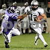 Beck Diefenbach – bdiefenbach@daily-chronicle.com<br /> <br /> Kaneland quarterback Joe Camiliere (12, right) runs with the ball during the first quarter of the game against Rochelle at Rochelle High School in Rochelle, Ill., on Friday sept. 24, 2010.