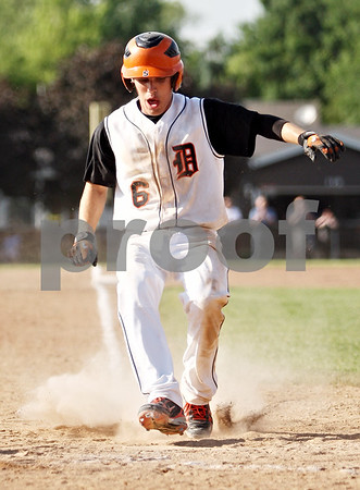 Rob Winner – rwinner@daily-chronicle.com<br /> <br /> DeKalb's Kevin Sullivan scores the winning run on an RBI single by Jake Gordon in the bottom of the seventh during the IHSA Class 3A DeKalb Sectional semifinal on Wednesday June 2, 2010 in DeKalb, Ill.
