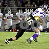 Wendy Kemp - For The Daily Chronicle<br /> Sycamore's Scotty Baker tries to take down Rochelle's C.J. Navarro during Friday's game.<br /> Sycamore 10/8/10