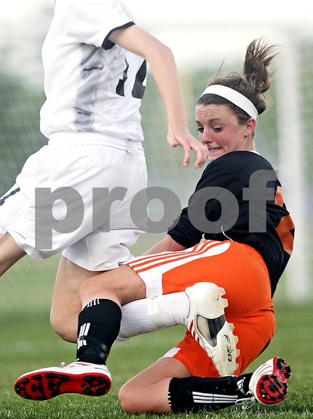 Beck Diefenbach  -  bdiefenbach@daily-chronicle.com<br /> <br /> DeKalb's Allison Anderson (2, right) trips on the leg of Sycamore's Lauren Miller (17) during the second half of the IHSA Class 2A Rochelle Regional Championship at Rochelle Township High School in Rochelle, Ill., on Friday May 21, 2010. Sycamore defeated DeKalb 2 to 1.