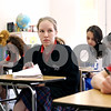 Rob Winner – rwinner@daily-chronicle.com<br /> Eighth grader Sarah Bruckner, 13, of St. Mary School in DeKalb, Ill., takes notes during her language arts studies in preparation of an upcoming vocabulary quiz on Thursday February 25, 2010. Bruckner will be taking part in the DeKalb County Spelling Bee at Kishwaukee College in Malta on Saturday.
