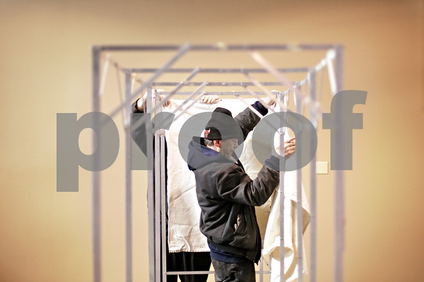Beck Diefenbach  -  bdiefenbach@daily-chronicle.com<br /> <br /> Rodney McKiness, of Blue Van and Storage, sets up voting booths at Harvest Bible Chapel in DeKalb, Ill., on Monday Feb. 1, 2010.