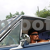 Beck Diefenbach  -  bdiefenbach@daily-chronicle.com<br /> <br /> Charles Lucero, of DeKalb, sits in his 1963 Chevrolet Impala as he watches other classic cars arrive for the Kishwaukee Fest Kruise Night in DeKalb, Ill., on Friday July 30, 2010.