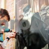"Beck Diefenbach - bdiefenbach@daily-chronicle.com<br /> <br /> Jay Allen, of Shaw Craft Sign Company,  installs on of the panels of a mural on the exterior of the Genoa Public Library in Genoa, Ill., on Monday March 8, 2010. The mural recognized Genoa's role in the ""Good Roads Movement."""
