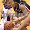 Kyle Bursaw – kbursaw@daily-chronicle.com<br /> <br /> Michelle Dumoulin gets a hand into DeKalb's Courtney Patrick's grasp in the first quarter. Hampshire defeated DeKalb 46-38 at DeKalb High School on Saturday, Nov. 27, 2010 during the Turkey Toss-Up tournament.