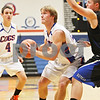Rob Winner – rwinner@daily-chronicle.com<br /> <br /> Genoa-Kingston's Robert Thurlby is fouled on his way to the basket in the first quarter in Genoa on Monday night. Genoa-Kingston went on to defeat Hinckley-Big Rock, 72-51.