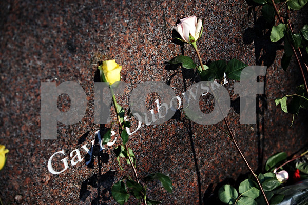 Beck Diefenbach – bdiefenbach@daily-chronicle.com<br /> <br /> Flowers lay on the memorial for shooting victim Gayle Dubowski following the wreath laying on NIU's campus in DeKalb, Ill., on Sunday Feb. 14, 2010.