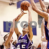 Beck Diefenbach  -  bdiefenbach@daily-chronicle.com<br /> <br /> Hampshire's Sarwan Khan (45, center) shoots the ball above Genoa-Kingston's Christopher Barthel (33, left) during the second quarter of the game at Genoa-Kingston High School in Genoa, Ill., on Monday Jan. 11, 2009. Hampshire defeated G-K 57 to 52.