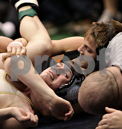 Beck Diefenbach - bdiefenbach@daily-chronicle.com<br /> <br /> Sycamore's Thomas Ernster (left) wrestles against Crystal Lake Central's Jason Fugiel during the 130 weight class match of the IHSA Class 2A dual team state tournament at the U.S. Cellular Coliseum in Bloomington, Ill., on Saturday Feb. 27, 2010.