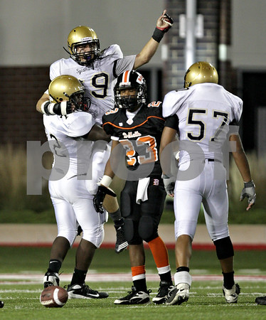 Beck Diefenbach – bdiefenbach@daily-chronicle.com<br /> <br /> Sycamore's Dorian Hryniewicki (69) celebrates after sacking the DeKalb quarterback during the fourth quarter of the Castle Challenge game between DeKalb and Sycamore High Schools at Huskie Stadium on the campus of Northern Illinois University in DeKalb, Ill., on Friday Sept. 10 2010.