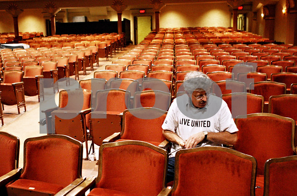 Rob Winner – rwinner@daily-chronicle.com<br /> <br /> Day of Caring volunteer Larry Apperson helps repair the seats at the Egyptian Theatre in DeKalb, Ill. on Thursday September 16, 2010.