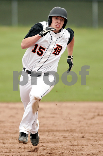 Beck Diefenbach  -  bdiefenbach@daily-chronicle.com<br /> <br /> DeKalb's Ben Dallesasse (15) curves to round third base as heads home to score and tie the game during the fifth inning against Geneva at DeKalb High School in DeKalb, Ill., on Wednesday May 12, 2010. DeKalb defeated Geneva 4 to 3.
