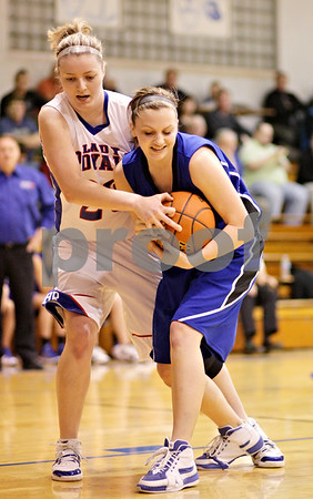 Beck Diefenbach  -  bdiefenbach@daily-chronicle.com<br /> <br /> Hinckley-Big Rock's Jenna Thorp (20, left) tries to take the ball from Newark's Katie Larson (12) during the first quarter of the game at H-BR High School in Hinckley, Ill., on Thursday Jan. 14, 2010. H-BR defeated Newark 46 to 30.