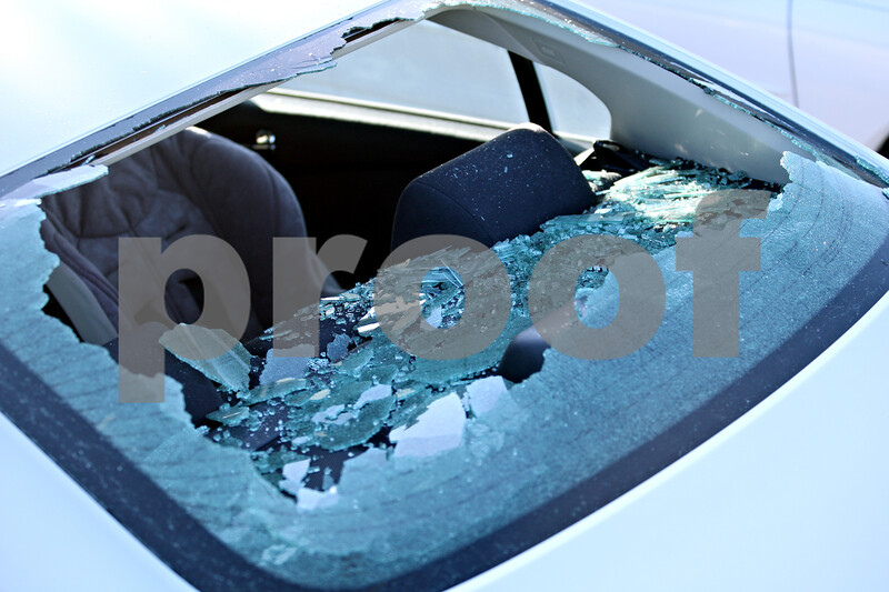 Beck Diefenbach  -  bdiefenbach@daily-chronicle.com<br /> <br /> Glass lays shattered in the interior of a car parked in the residential lot next to the sycamore High School softball field after a foul ball hit the vehicle in Sycamore, Ill., on May 27, 2010.