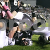 Rob Winner – rwinner@daily-chronicle.com<br /> <br /> Kaneland's Quinn Buschbacher is tackled after a reception in the first quarter of their game in Maple Park, Ill. on Friday October 15, 2010.