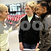 Beck Diefenbach  -  bdiefenbach@daily-chronicle.com<br /> <br /> New Northern Illinois women's head coach Kathi Bennett (left) talks to basketball players Courtney Shelton (center) and Terriel Cannon (right) following her introduction at the NIU Convocation Center in DeKalb, Ill., on Tuesday May 18, 2010.