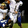 Beck Diefenbach  -  bdiefenbach@daily-chronicle.com<br /> <br /> Sycamore running back Marckie Hayes (1) breaks through the grasp of Burlington Central defenders during the first quarter of the game at Burlington Central High School in Hampshire, Ill., on Friday Sept. 4, 2009.