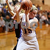 Beck Diefenbach – bdiefenbach@daily-chronicle.com<br /> <br /> Hinckley-Big Rock's Jes Meyer (15, front) takes the ball away from Amboy's Taylor Corcoran (3) during the third quarter of the IHSA Class 1A Regional Final game at Indian Creek High School in Shabbona, Ill., on Thursday Feb 11, 2010.