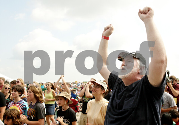 Beck Diefenbach - bdiefenbach@daily-chronicle.com<br /> <br /> Jim Doyle, of DeKalb, sings along as American English performs at Cornfest at the DeKalb Municipal Airport in DeKalb, Ill., on Saturday Aug. 21, 2010.
