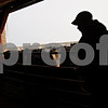 Beck Diefenbach  -  bdiefenbach@daily-chronicle.com<br /> <br /> Kristian Knutson, 24, prepares to open the gate to let cattle in side for the night on his family's farm in Malta, Ill., on Monday Feb. 1, 2010.