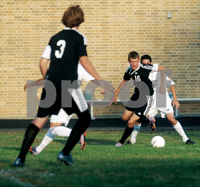 Sycamore's Adam Westerby controls the ball during Tuesday's game at Dixon High School.