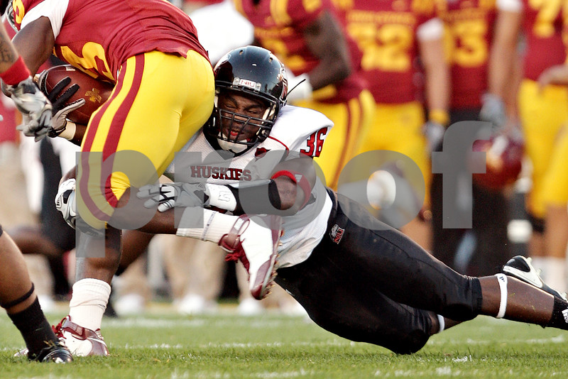 Beck Diefenbach  -  bdiefenbach@daily-chronicle.com<br /> <br /> Iowa State running back Alexander Robinson (33, left) is taken down by Northern Illinois linebacker Tyrone Clark (36) during the first quarter of the game at Jack Trice Stadium on the campus of Iowa State University in Ames, Iowa, on Thursday Sept. 2, 2010. Iowa State defeated Northern Illinois 27 to 10.