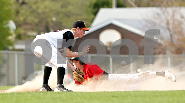 Beck Diefenbach  -  bdiefenbach@daily-chronicle.com<br /> <br /> Batavia's Braden Hrack (20, bottom) slides safe into third base as DeKalb's Jake Gordon (10) catches the ball during the third inning of the game at DeKalb High School in DeKalb, Ill., on Thursday April 15, 2010. Batavia defeated DeKalb 7 to 4.