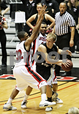 Beck Diefenbach  -  bdiefenbach@daily-chronicle.com<br /> <br /> Northern Illinois' Jake Anderson (32, left) and Xavier Silas (13, back) drive Western Michigan's David Kool (23) into a corner during the second half of the game at the Convocation Center at NIU in DeKalb, Ill., on Wednesday Jan. 13, 2010.